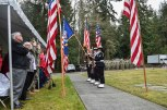 """GARDINER, Wash. (Nov. 11, 2016) Naval Hospital Bremerton color guard present the colors while Navy Band Northwest performs """"The Star Spangled Banner"""" during a Veterans Day ceremony hosted by Naval Facilities Engineering Command Northwest at Gardiner Cemetery. The ceremony paid tribute to the only Seabee Medal of Honor recipient and Vietnam veteran, Construction Mechanic 3rd Class Marvin Glenn Shields, who was posthumously awarded the nation's highest military award for his actions taken and giving his life to save comrades while under enemy attack. (U.S. Navy photo by Petty Officer 1st Class Cory Asato/Released)"""