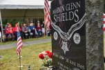 GARDINER, Wash. (Nov. 11, 2016) The grave of Construction Mechanic 3rd Class Marvin Glenn Shields stands adorned with tributes from fellow Seabees, friends and family as the centerpiece during a Veterans Day ceremony hosted by Naval Facilities Engineering Command Northwest at Gardiner Cemetery. The ceremony paid tribute to the only Seabee Medal of Honor recipient and Vietnam veteran, Shields, who was posthumously awarded the nation's highest military award for his actions taken and giving his life to save comrades while under enemy attack. (U.S. Navy photo by Petty Officer 1st Class Cory Asato/Released)