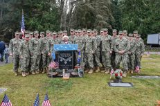 GARDINER, Wash. (Nov. 11, 2016) Mrs. Joan Shields-Bennett, widow of Construction Mechanic 3rd Class Marvin Glenn Shields, poses for a photo with local Seabees after a Veterans Day ceremony hosted by Naval Facilities Engineering Command Northwest at Gardiner Cemetery. The ceremony paid tribute to the only Seabee Medal of Honor recipient and Vietnam veteran, Shields, who was posthumously awarded the nation's highest military award for his actions taken and giving his life to save comrades while under enemy attack. (U.S. Navy photo by Petty Officer 1st Class Cory Asato/Released)