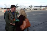 161230-N-DC740-048 OAK HARBOR, Wash. (Dec. 30, 2016) Lt. David Ritchy, Electronic Attack Squadron 130, talks to his fiancée after returning home from deployment at Naval Air Station Whidbey Island. Electronic Attack Squadron 130 conducted electronic warfare operations in the 5th Fleet area of responsibility while embarked on USS Dwight D. Eisenhower (CVN 69). (U.S. Navy photo by Mass Communication Specialist 2nd Class John Hetherington/Released)
