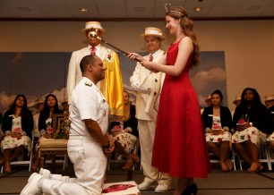 170609-N-WX604-091 PORTLAND, Ore. (June 9, 2017) Rear Adm. Gary Mayes, commander, Navy Region Northwest, is knighted during the Royal Rosarian Honorary Knighting ceremony in Portland. The festival and Portland Fleet Week are a celebration of the sea services with Sailors, Marines, and Coast Guard members from the U.S. and Canada making the city a port of call. (U.S. Navy photo by Mass Communication Specialist 2nd Class Joseph Montemarano/Released)