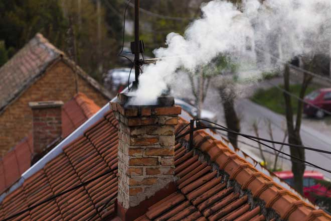 Smoke Exiting Brick Chimney