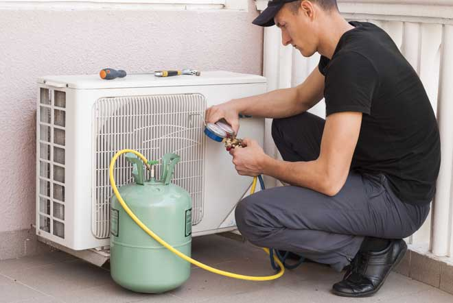 Man Refilling Air Conditioner with Freon