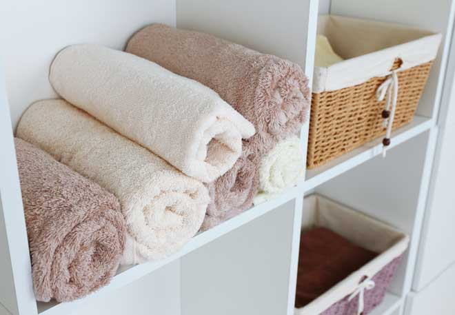 Bathroom Shelves with Towels and Baskets