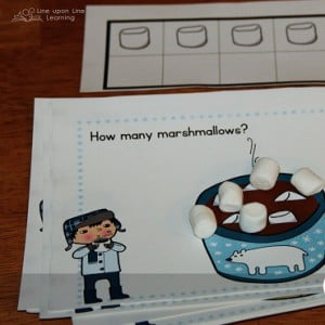 Marshmallow counting. When she did not know the number, she could move the marshmallows to the ten frame to figure out how many were in each cup of cocoa. Free printable on this post. -Line upon Line Learning blog