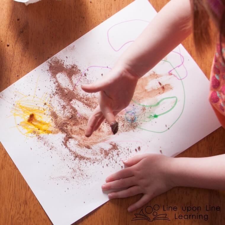 """Of course, after we """"paint"""" with chocolate, we get to lick our fingers!"""