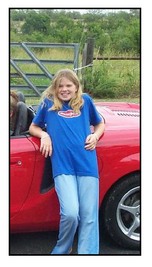 Red car Lacey wearing dark blue shirt and light blue pants