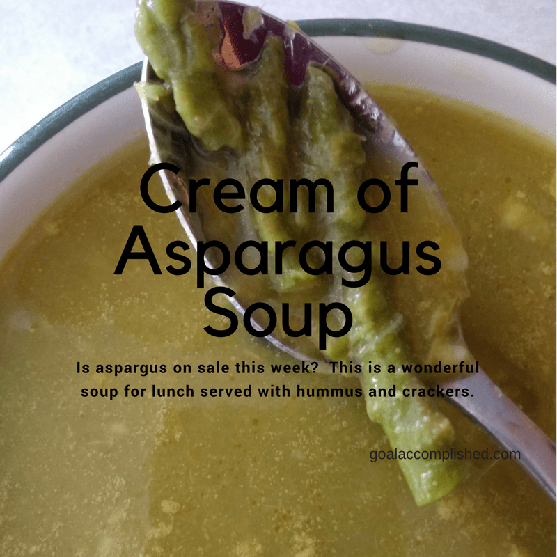 Bowl of cream of asparagus soup. This is delicious with hummus and crackers