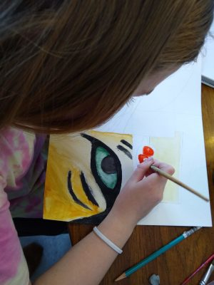 Student has painted a tiger eye.