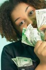 girl-peeks-around-money