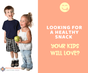 looking for a healthy snack your kids will love/ Smiling kids holding an apple