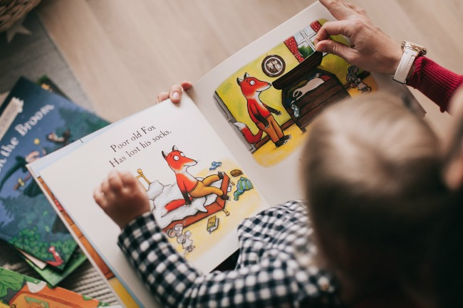 Teaching How To Read Is Sucking All The Fun (DO THIS INSTEAD): small child reading a book