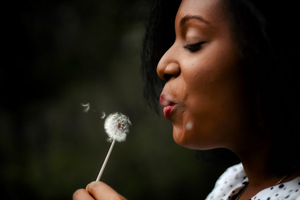Can Parents Avoid Homeschool Qualification Requirements? woman blowing on a flower