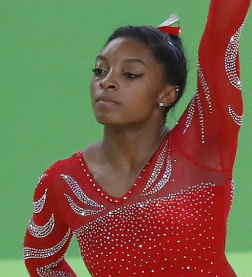 Simone Biles in red gymnastic outfit
