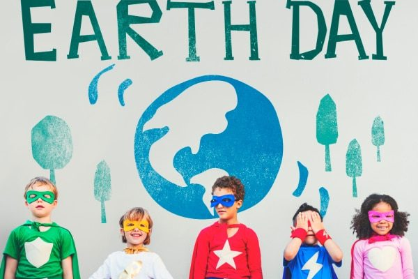 Earth Day Activities for Kids with a line of young kids dressed like super heroes