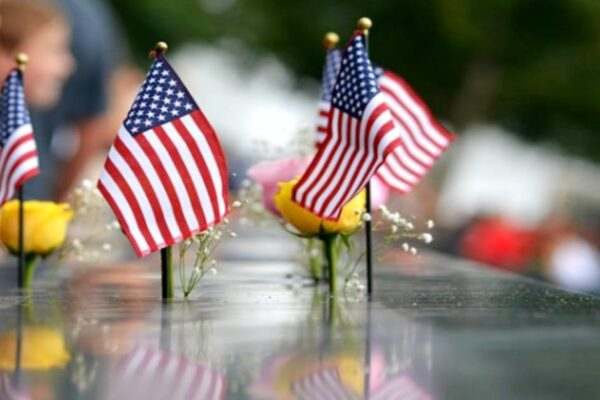 Teaching 9 11 for kids lessons mini American flags and yellow roses on September 11 memorial