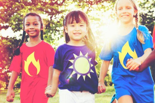 Women's History Month black, asian, white girls smiling and running outside