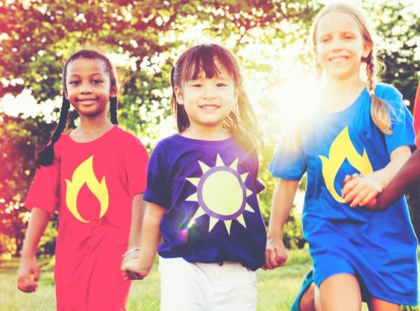 Women's History Month: black, asian, white girls smiling and running outside