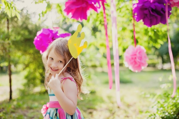 young girl with party decorations celebrating make up your own holiday day outside