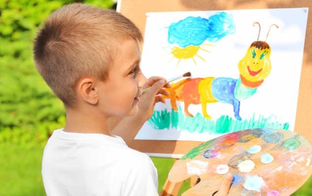 Flexible Homeschool Schedule with young boy painting outdoors during a homeschooling class