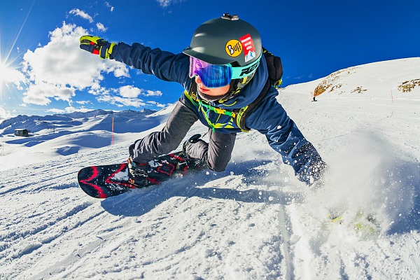 Winter Olympics Lesson Plans and Activities for Winter Olympics Sports snowboarder on snow covered mountain