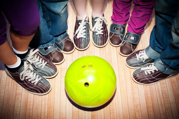 Free Kids Activities for Fun Family Time on a Tight Budget kids bowling shoes around a green bowling ball