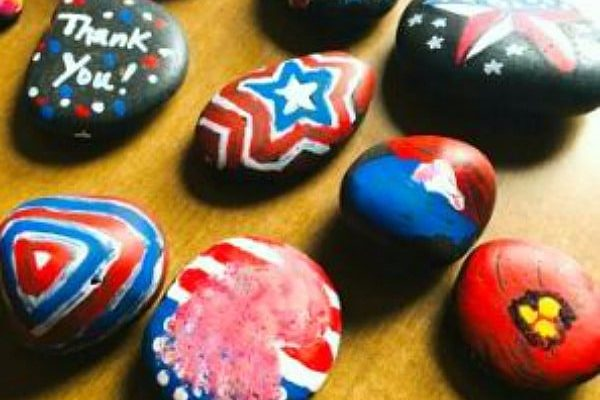 How to Make Kindness Rocks painted rocks on a table