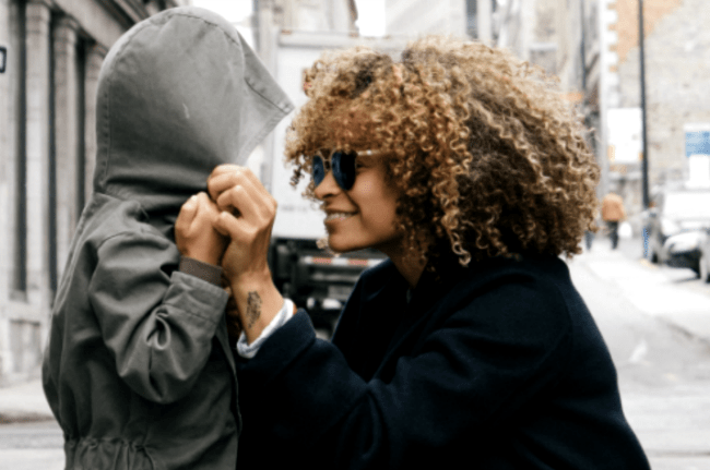 #5 IN HOW TO HOMESCHOOL SERIES: What Qualification Do You Need to Homeschool? Mom pulling a coat hood on a child's head