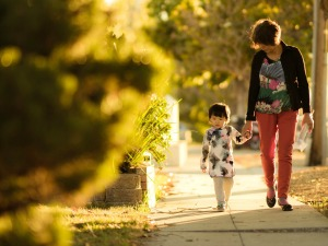 Why Do People Homeschool Reason #12 : Fits better into the family's schedule. Mom walking on sidewalk holding little girl's hand