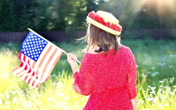 15 Memorial Day for Kids Crafts, Activities, Projects little girl in red dress and straw hat with back to camera holding american flag