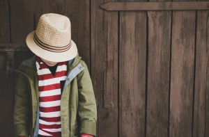 Can You Start Homeschooling at the End of the Year? boy wearing hat with head down