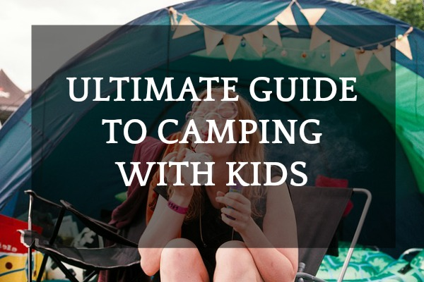 Guide to camping with kid text over a girl blowing soap bubbles in front of a tent