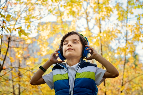#audiobooks #audio #books #childrensbook #childrensbooks #reading #readinglist #specialneeds #specialeducation #education #technology #dyslexia #homeschool #homeschooling boy in woods with headphones on listening with eyes closed