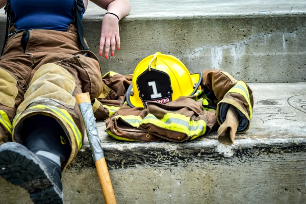 woman firefighter sitting on steps