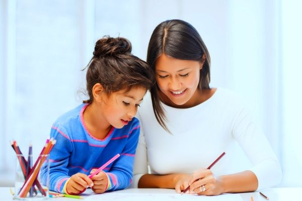 mother and daughter starting homeschool work at table