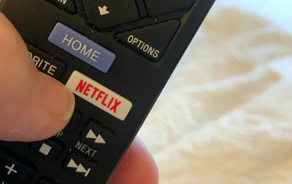 How To Use Netflix Party close up of a remote control showing a Netflix button