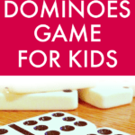How to Play Dominoes white dominoes with black dots on a brown table