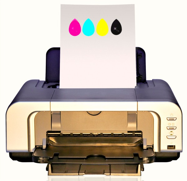 printer reviews with printer sitting on table with a piece of printing page paper