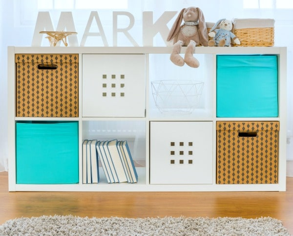 How To Organize Your Room: organized child's room shelves with different colored bins