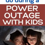 POWER OUTAGE IDEAS FOR KIDS kids reading with a flashlight under a blanket fort