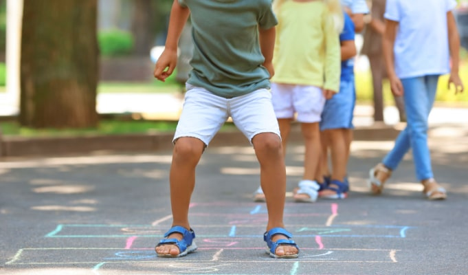 Last Day Of Homeschool Ideas legs of students doing hopscotch at end of school year