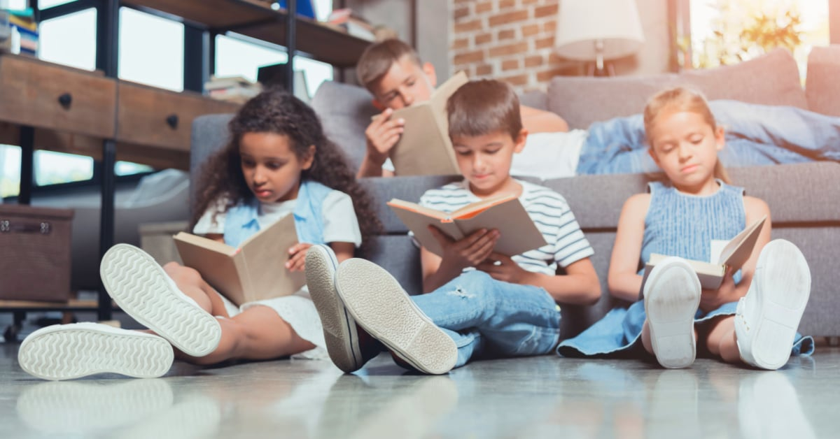 What Are Living Books kids of different ages reading living homeschool books