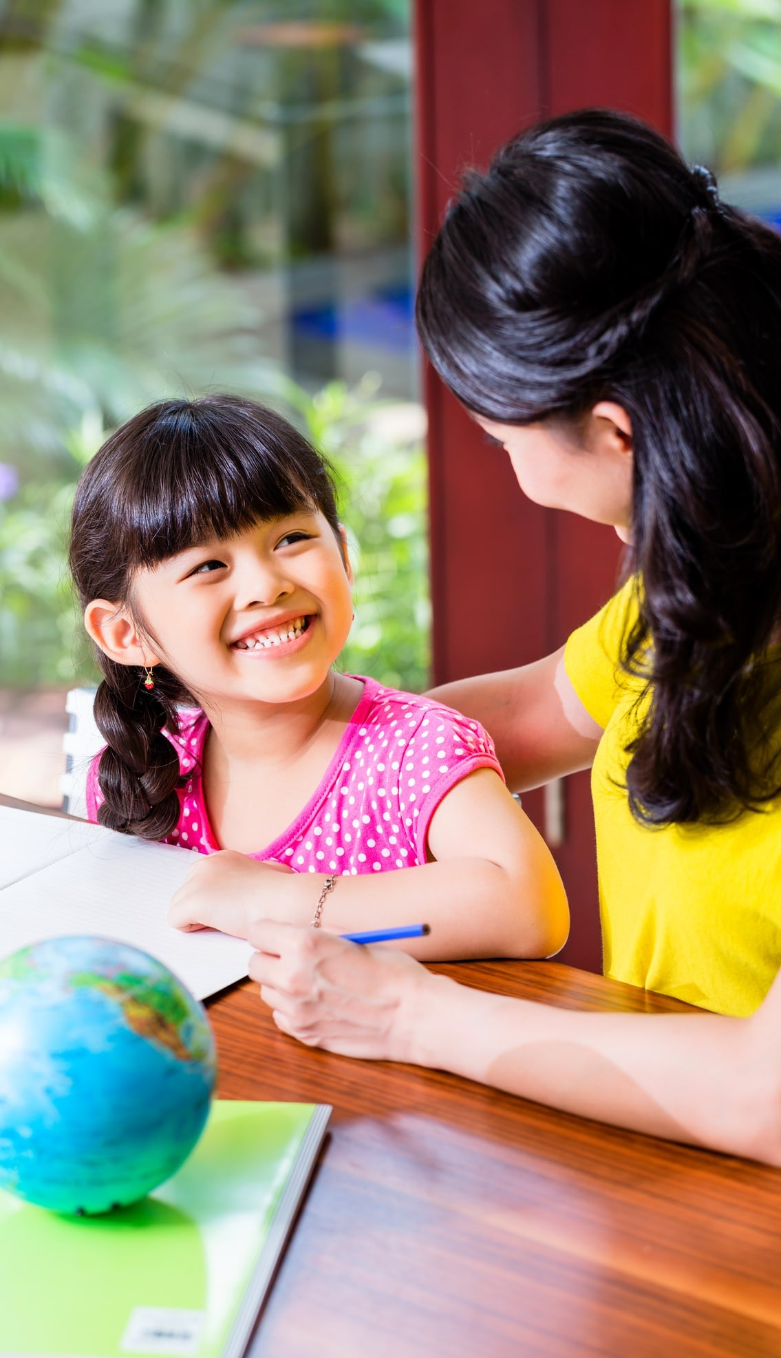 How To Prepare for Back to School Tips mother and daughter working on home school at a table