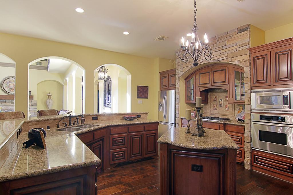 glossy oil rubbed bronze appliances in the kitchen brown marble countertop and kitchen island classic pendant lamp darker wood floors Oil Rubbed Bronze Kitchen Faucet