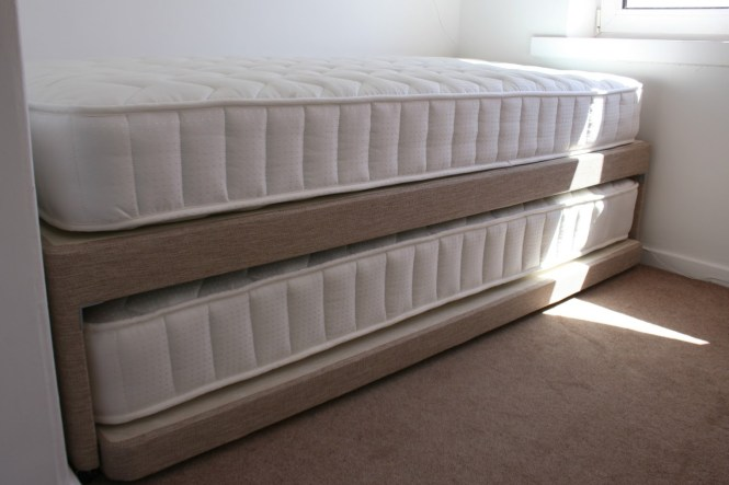 Double Bed With White Mattress For Guest Solutions