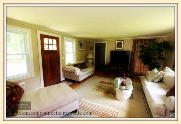 An inviting living room welcomes you inside this lovely New Milford CT home for sale.