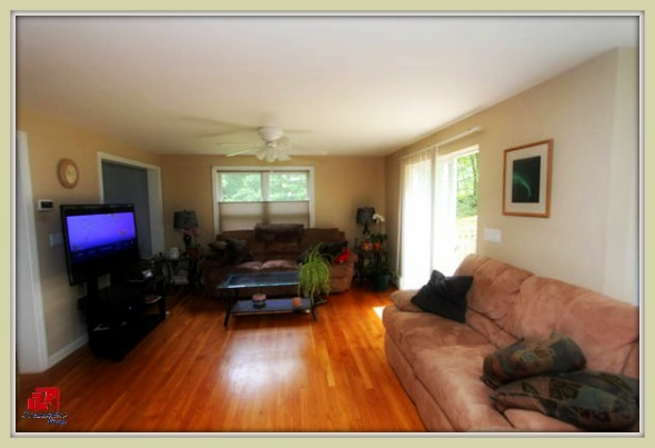 Relax and enjoy the comfort of the living room of this lovely Bethel CT home for sale.