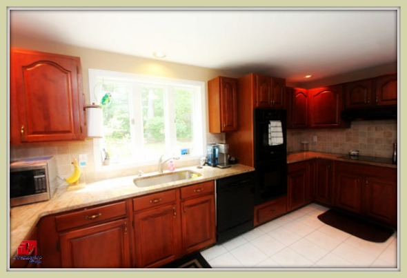 This colonial style Bethel CT home for sale boast of a fully functional kitchen equipped with appliances.