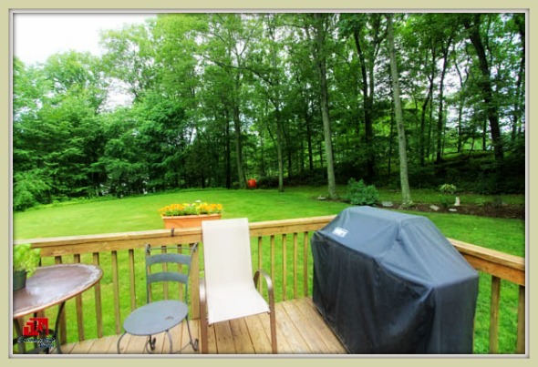 Enjoy weekend barbeques in the back yard deck of this lovely Bethel CT home for sale.