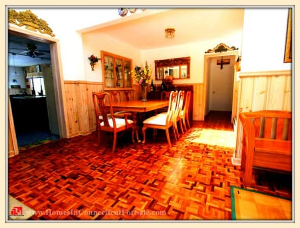 Enjoy sumptuous meals with your family and loved ones in the lovely dining room of this Holiday Point home for sale in Sherman CT.